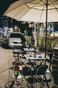 table and chairs under patio umbrella