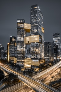 lighted high-rise buildings at nighttime