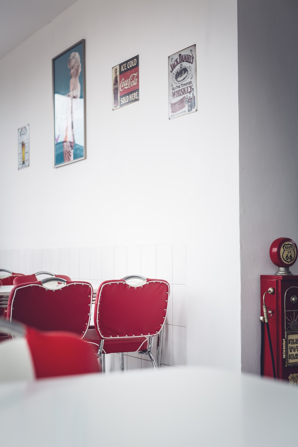empty chairs beside wall with posters and signs
