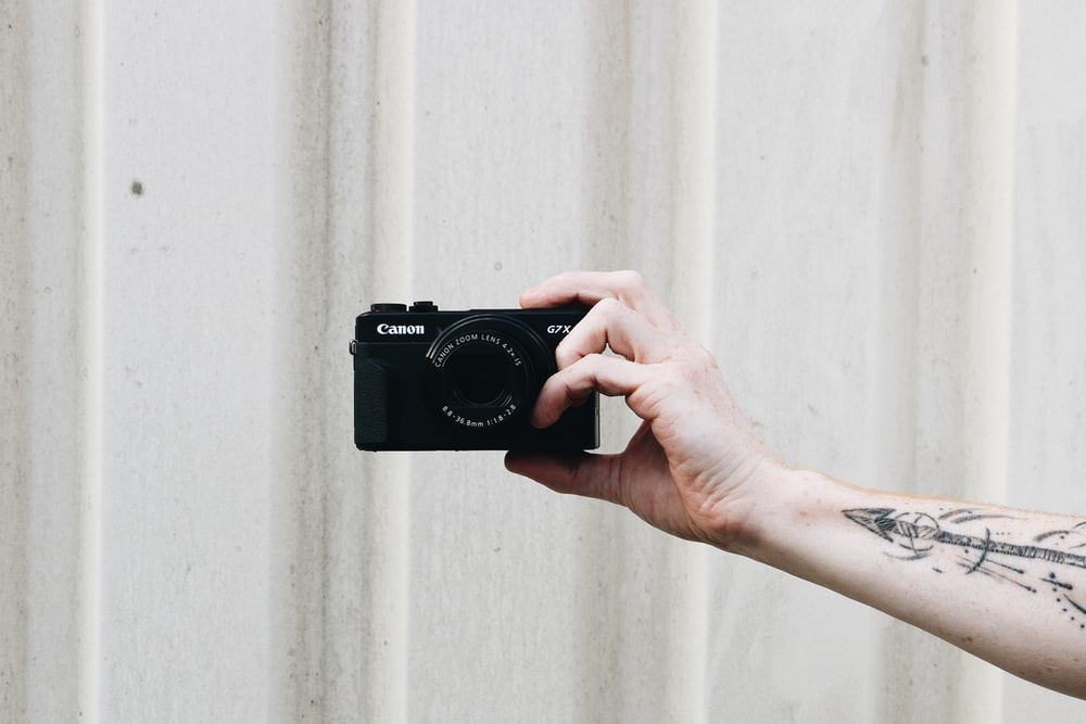 black Canon point-and-shoot camera