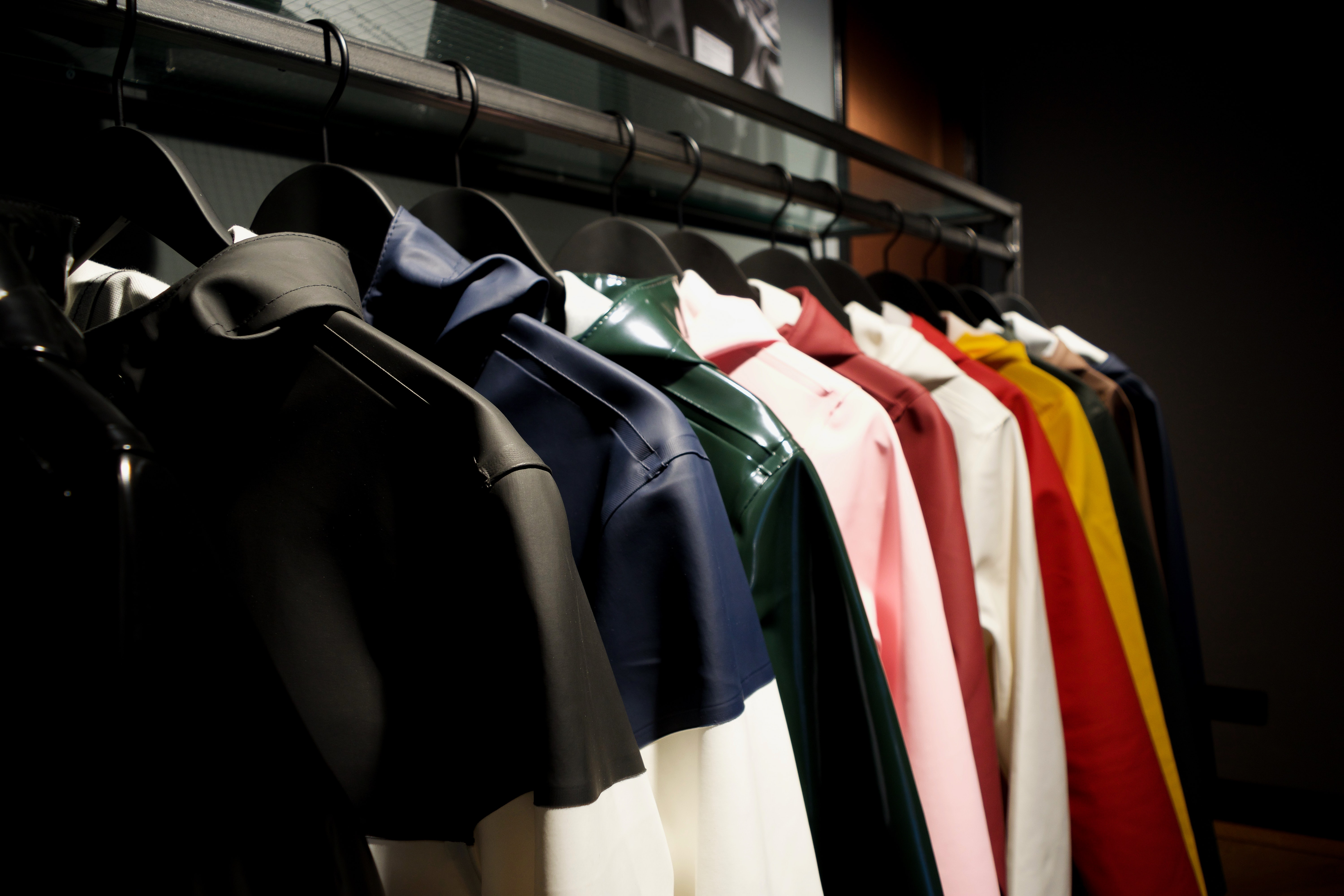 selective focus photography of hanged leather jackets with different colors