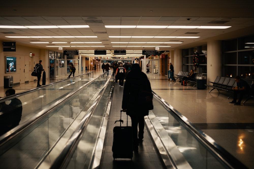 walking man holding luggage
