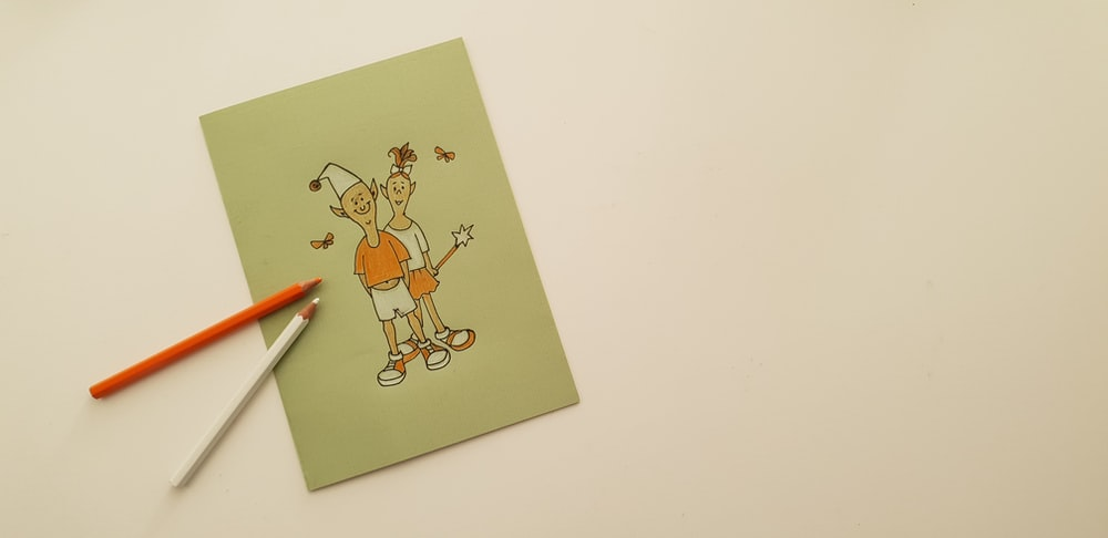 two character illustration and orange and white pencil