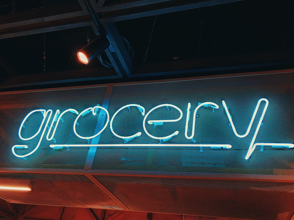 white grocery neon sign