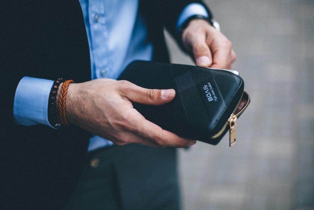 man holding long wallet
