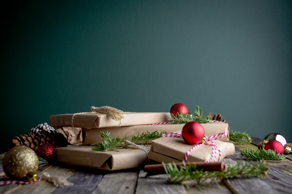 gift boxes with red baubles on top