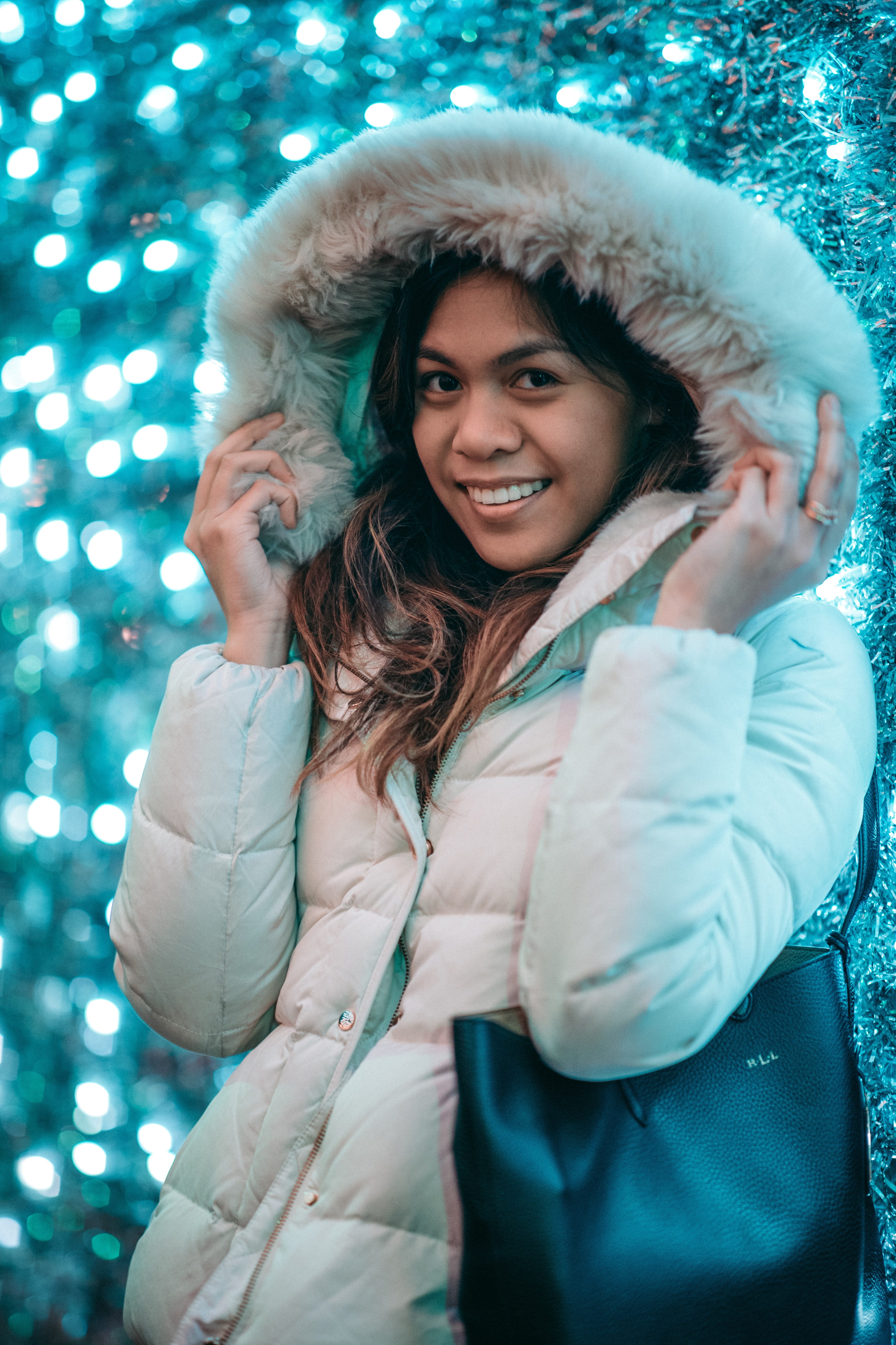 woman in parka jacket taking selfie while smiling