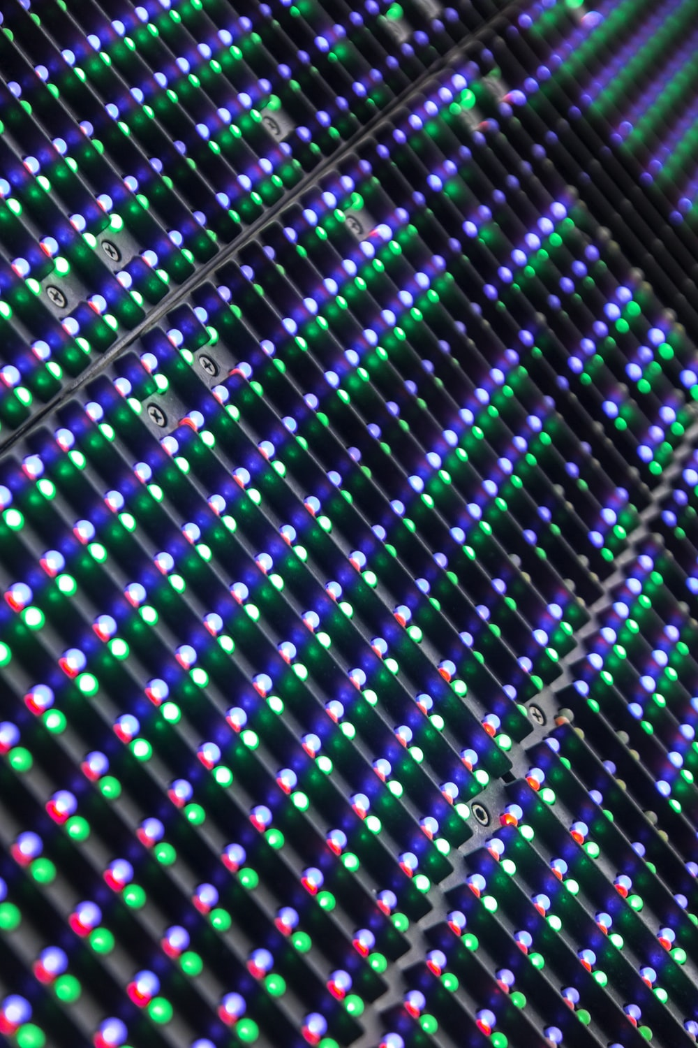 green, purple, and white textile
