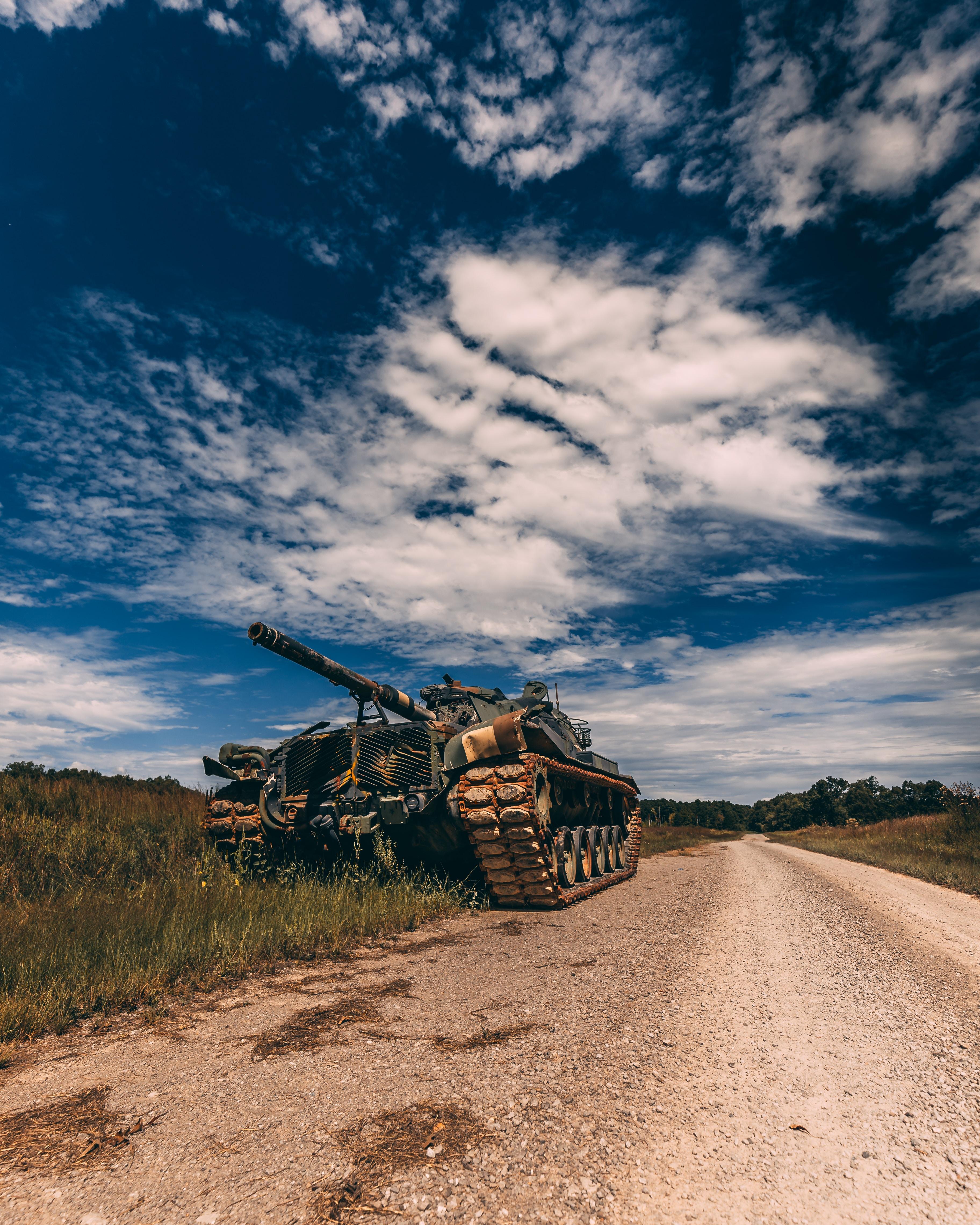 grey battle tank on road during daytime