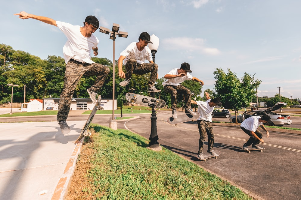 time-lapse photography of man doing skateboard tricks