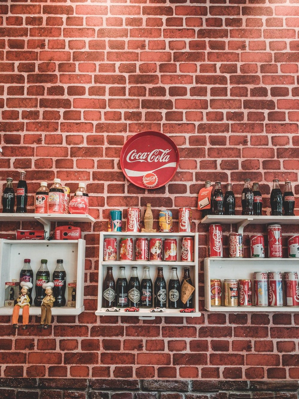 assorted design of Coca-Cola soda lot on display