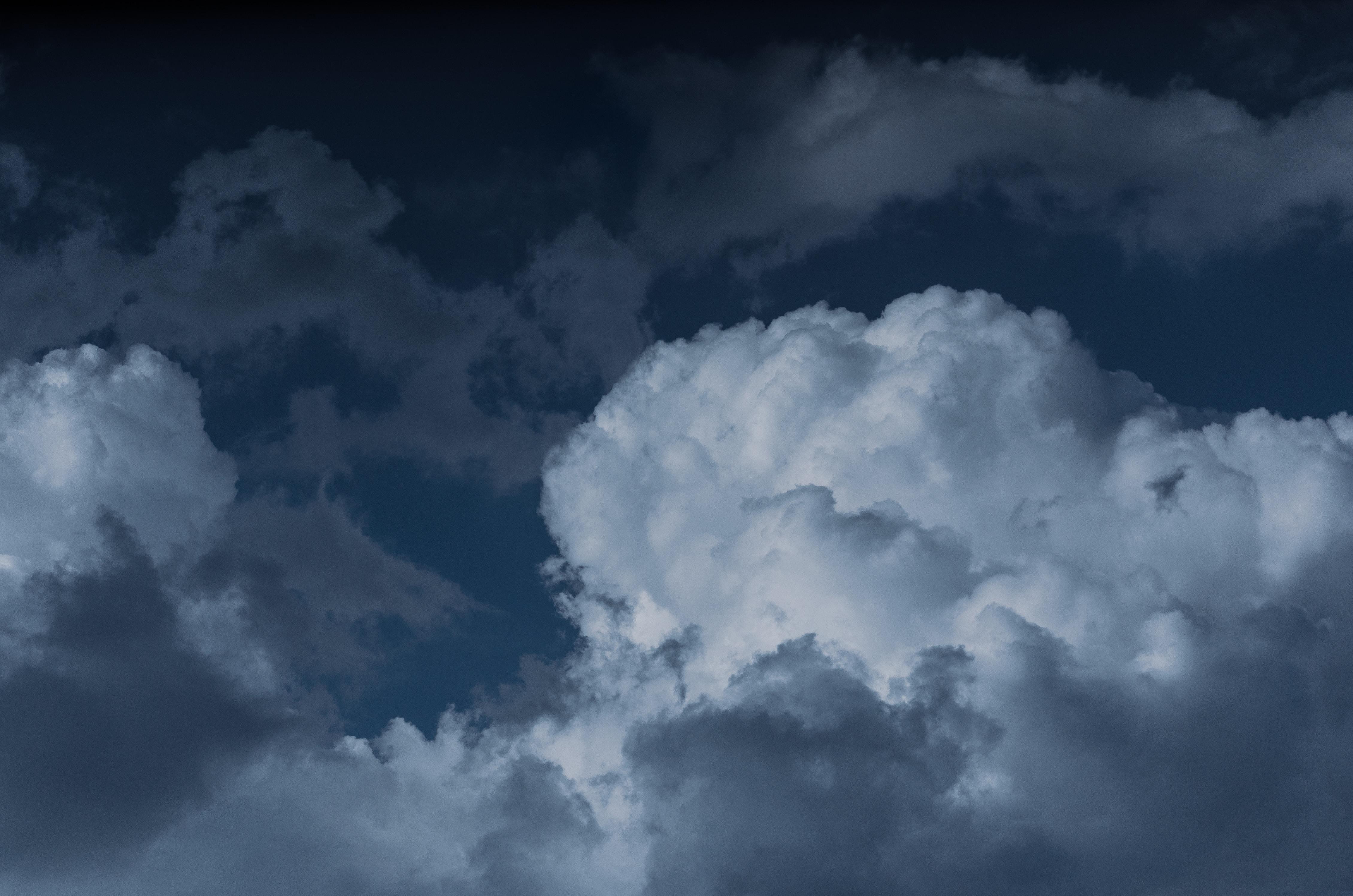 white cumulus clouds in sky