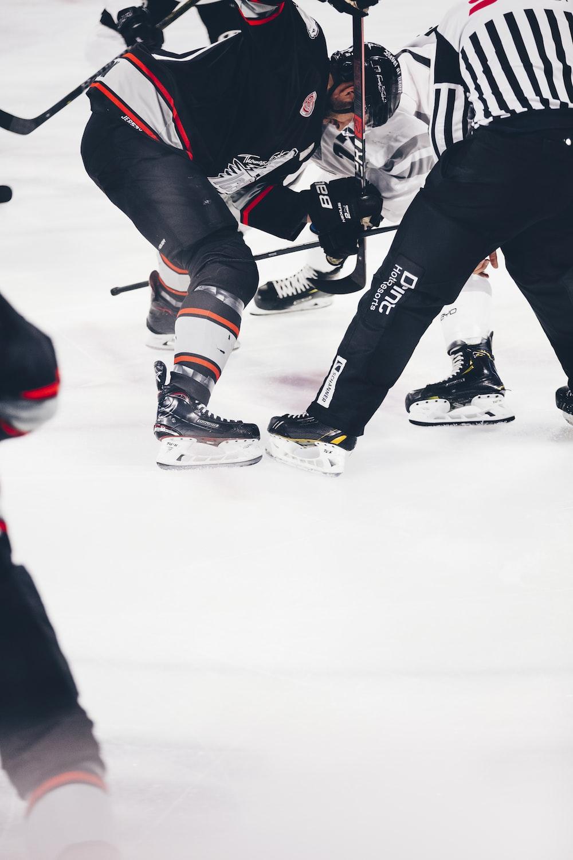 men playing hockey
