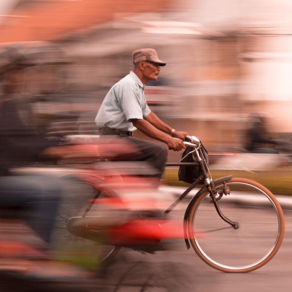 man riding black commuter bike