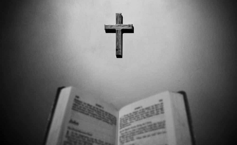 gray cross across book