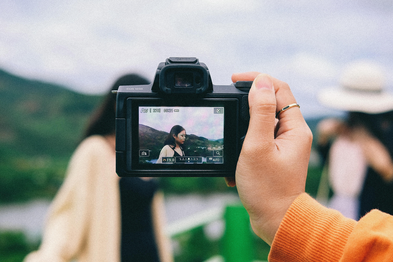 selective focus photography of black digital camera