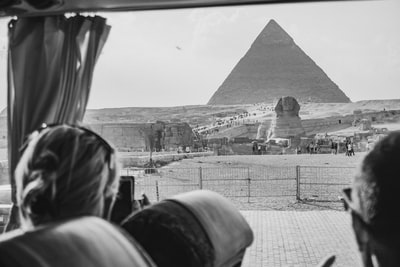 grayscale photography of the great sphinx of giza cairo teams background