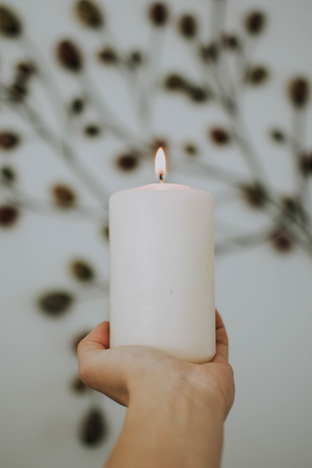 selective focus photography of lighted pillar candle