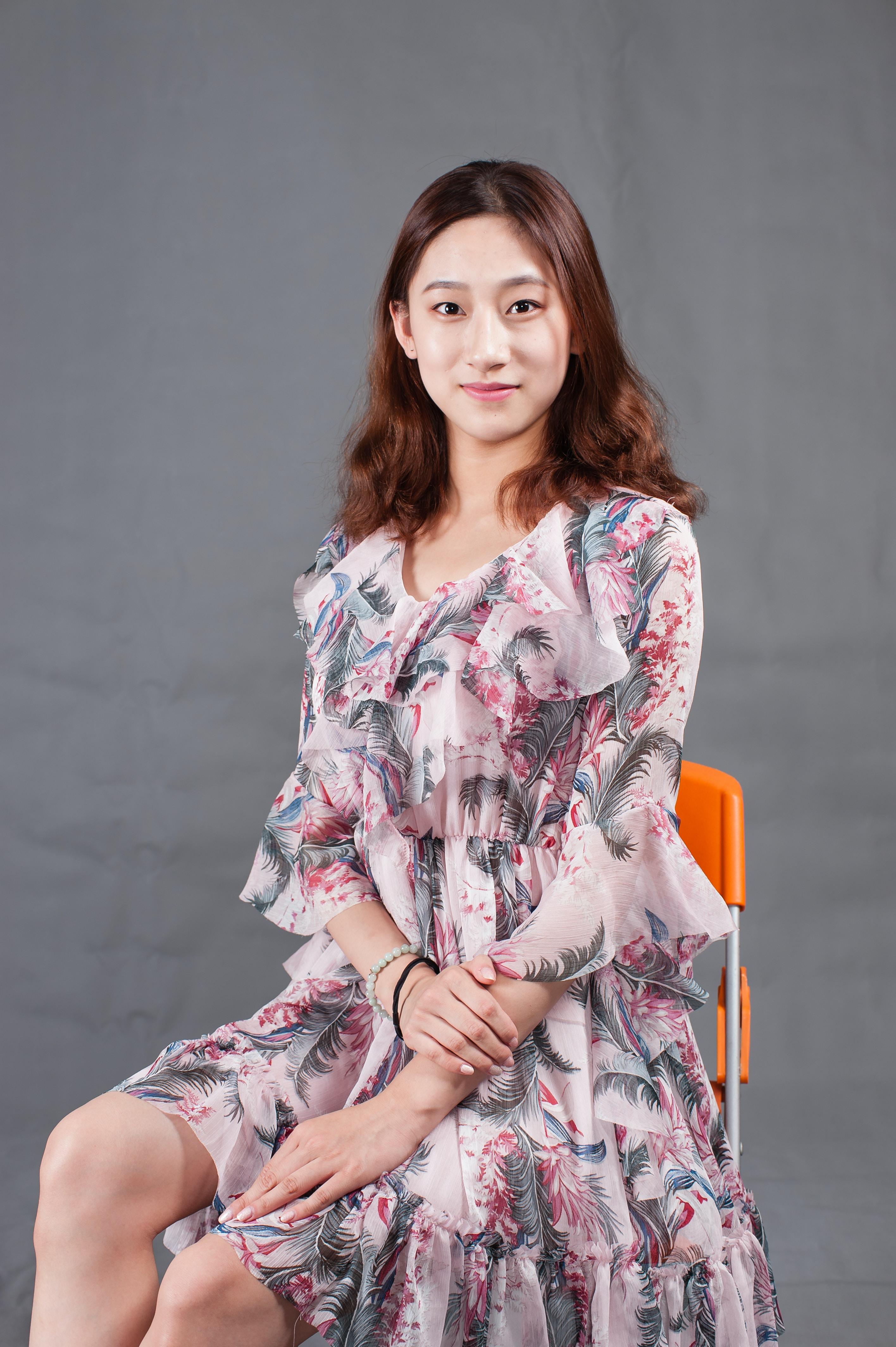 woman sitting on orange folding chair