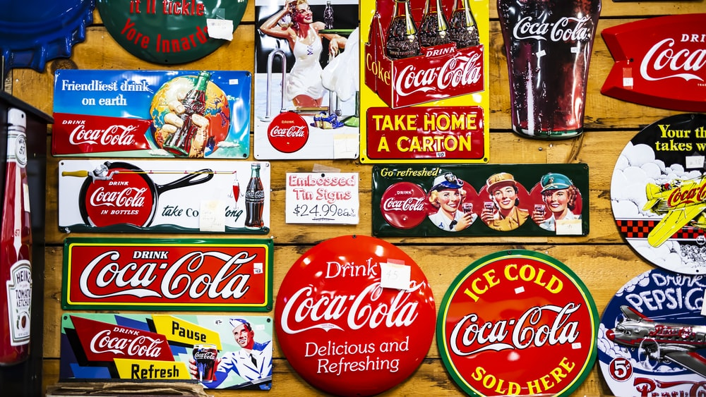 assorted Coca Cola sticker lot on wall