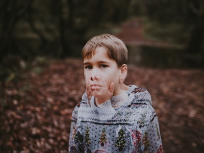 boy in gray and green sweater emotion zoom background