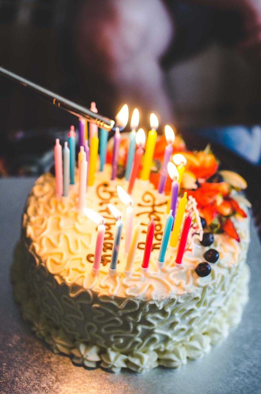 Icing Cake On Table Photo Free Birthday Cake Image On