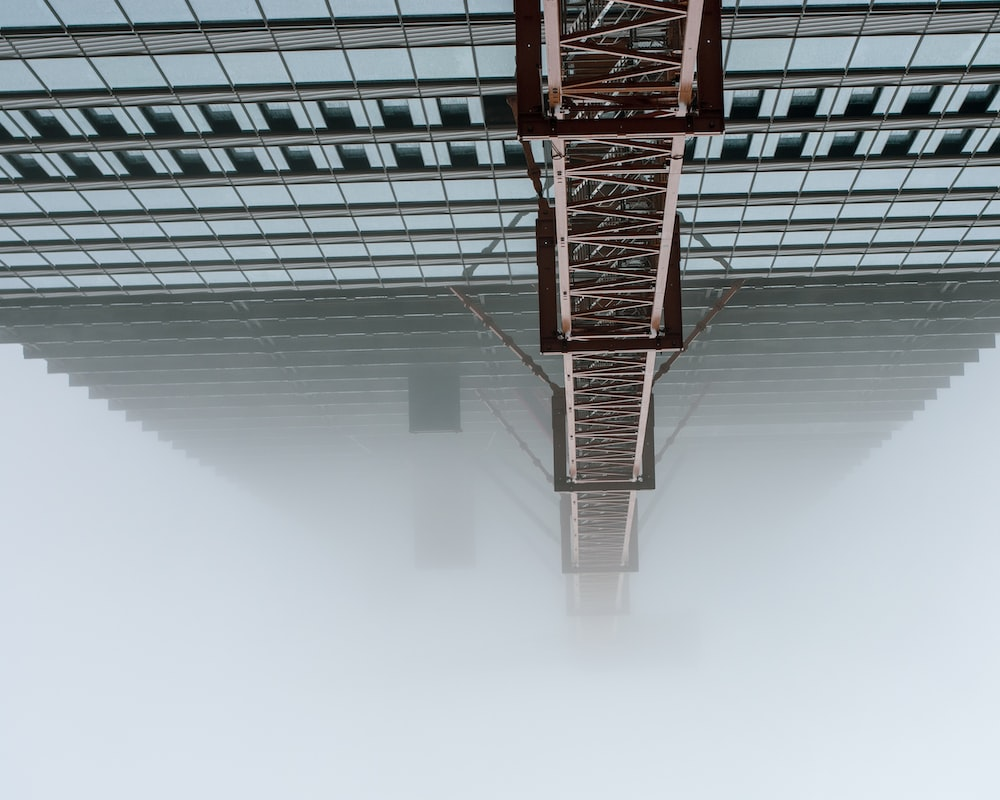 curtain wall high-rise building covered with fogs