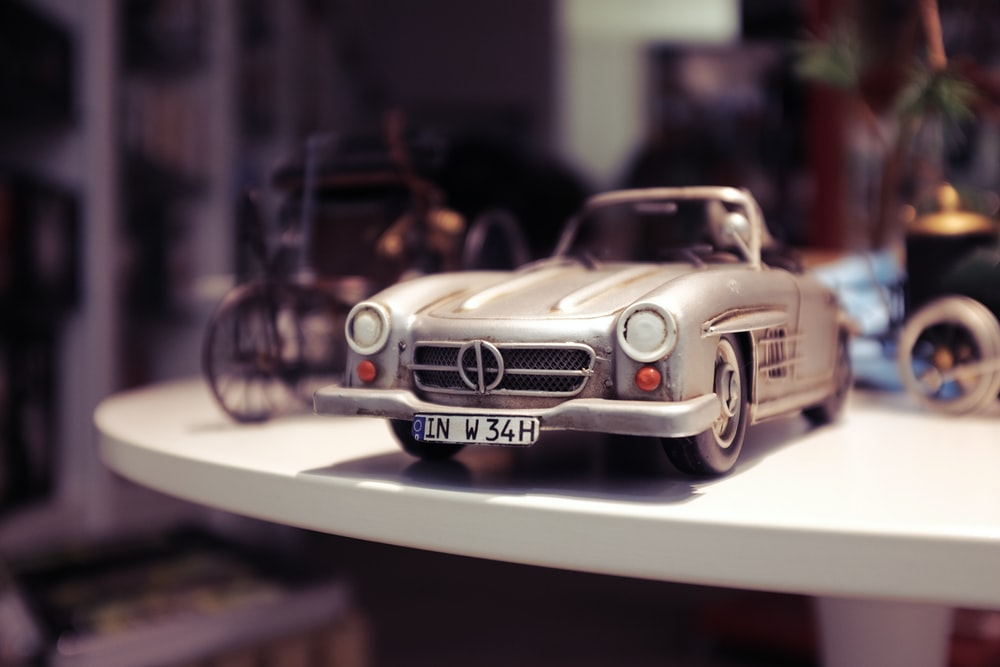 selective focus photography of gray vehicle scale model