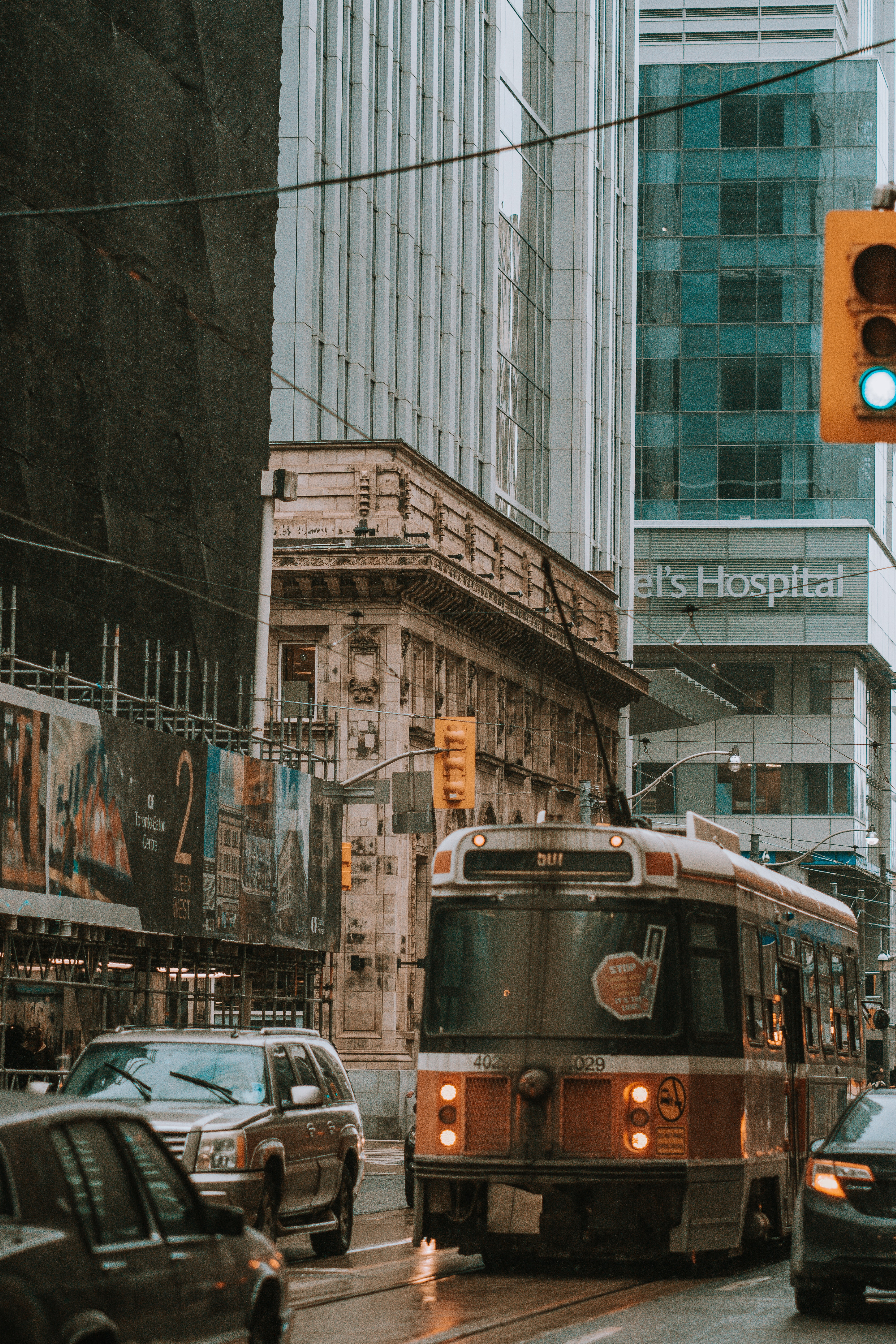 brown commuter bus on road near buildings during daytime