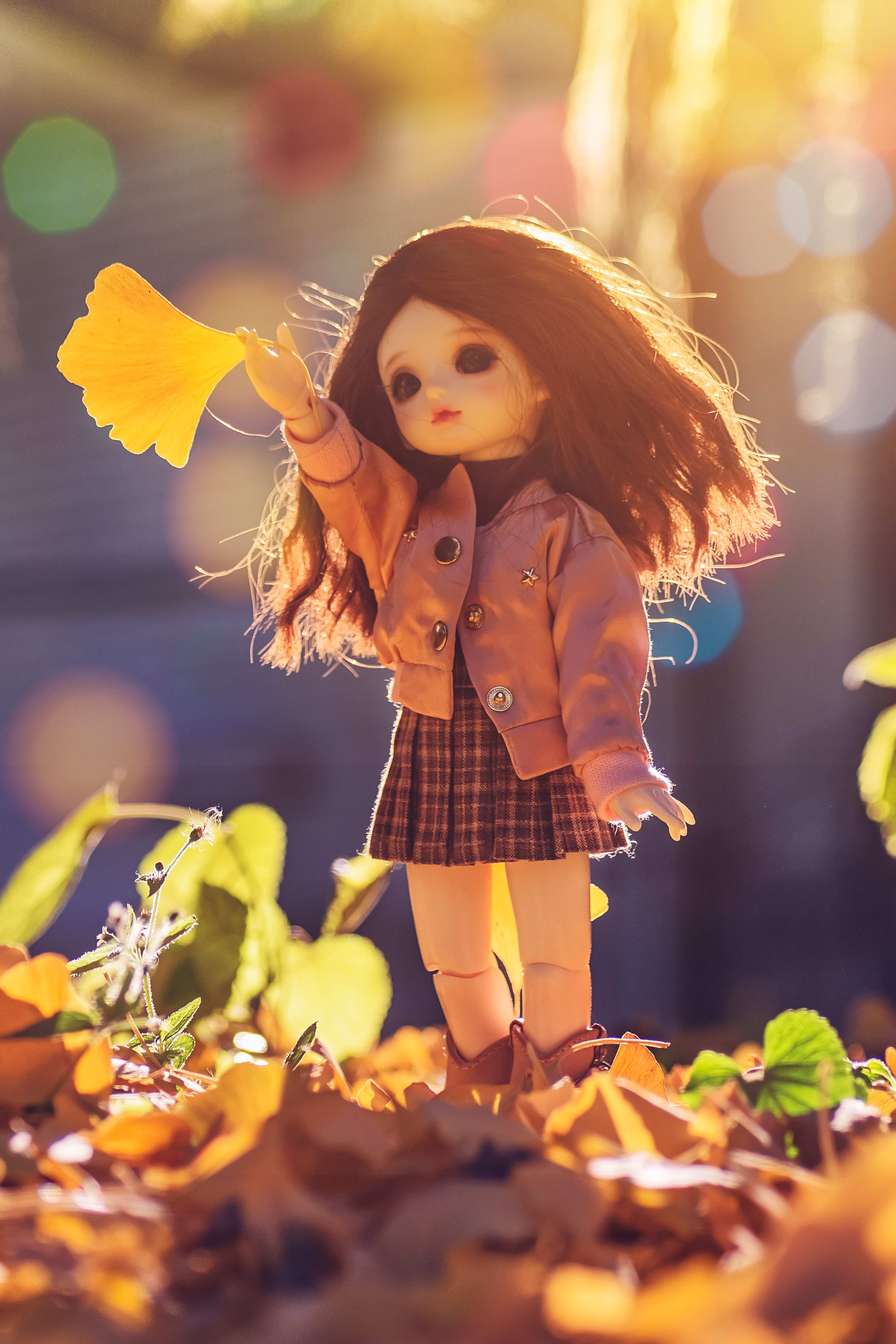 yellow and black dressed female doll