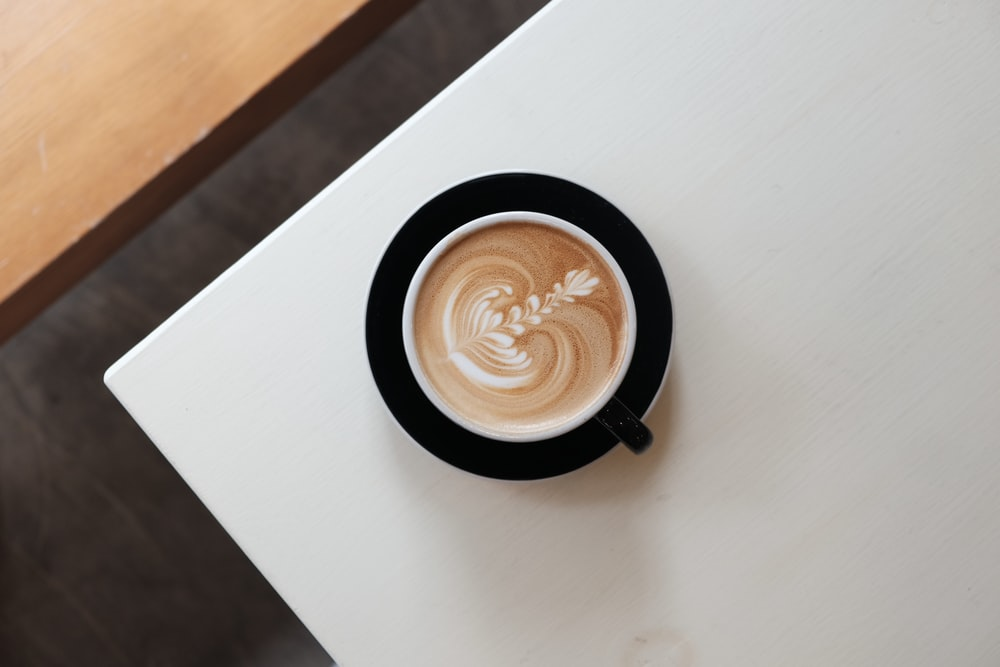 coffee in cup on white surface