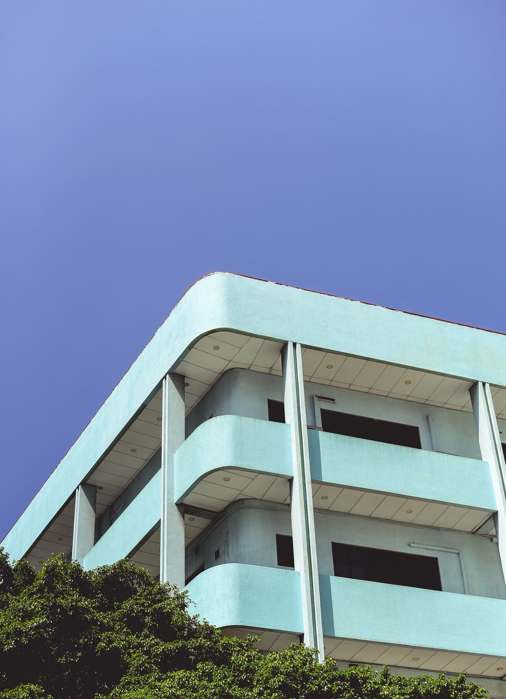 low angle photography of teal building