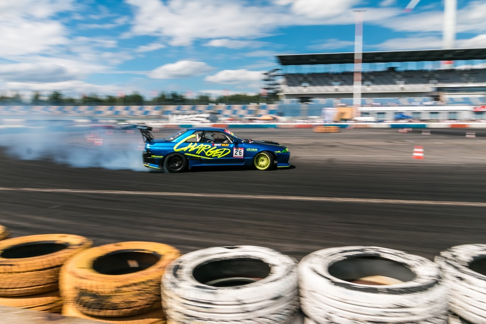 speeding car on race track during day