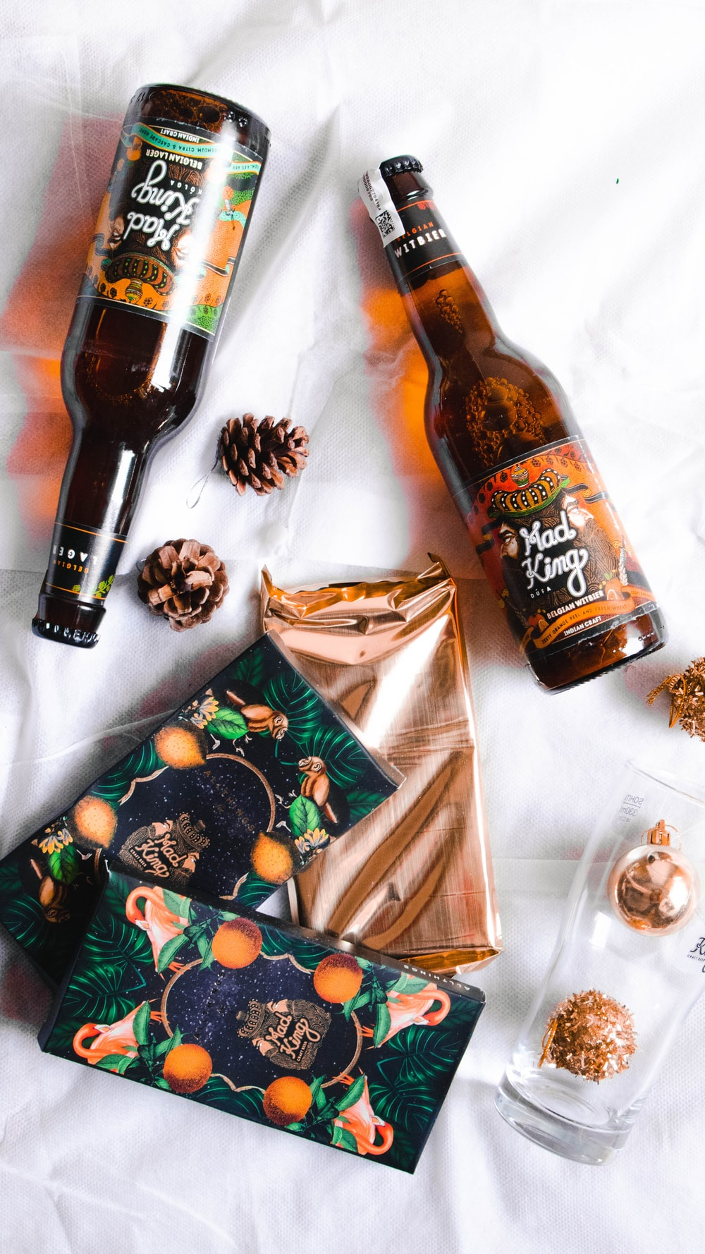 flat lay photography of Mad King beer on blanket