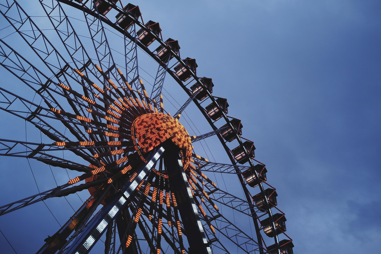 orange and black ferris wheel under blue sky