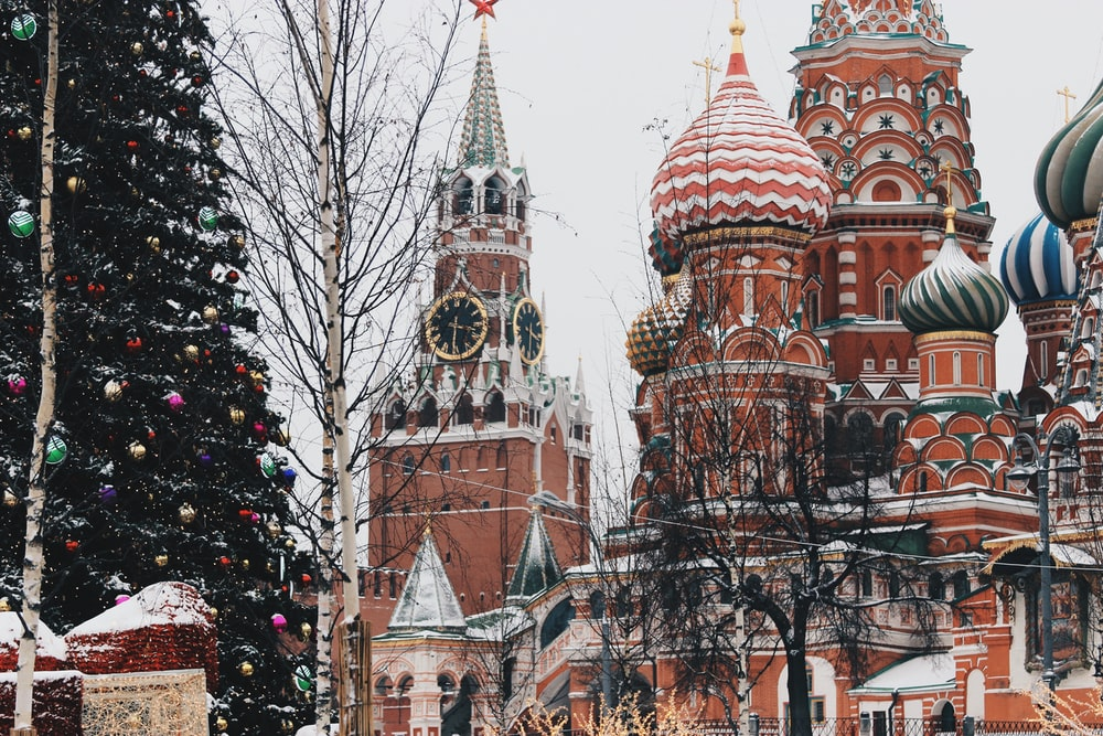 large Christmas tree near St. Basil's Cathedral during daytime