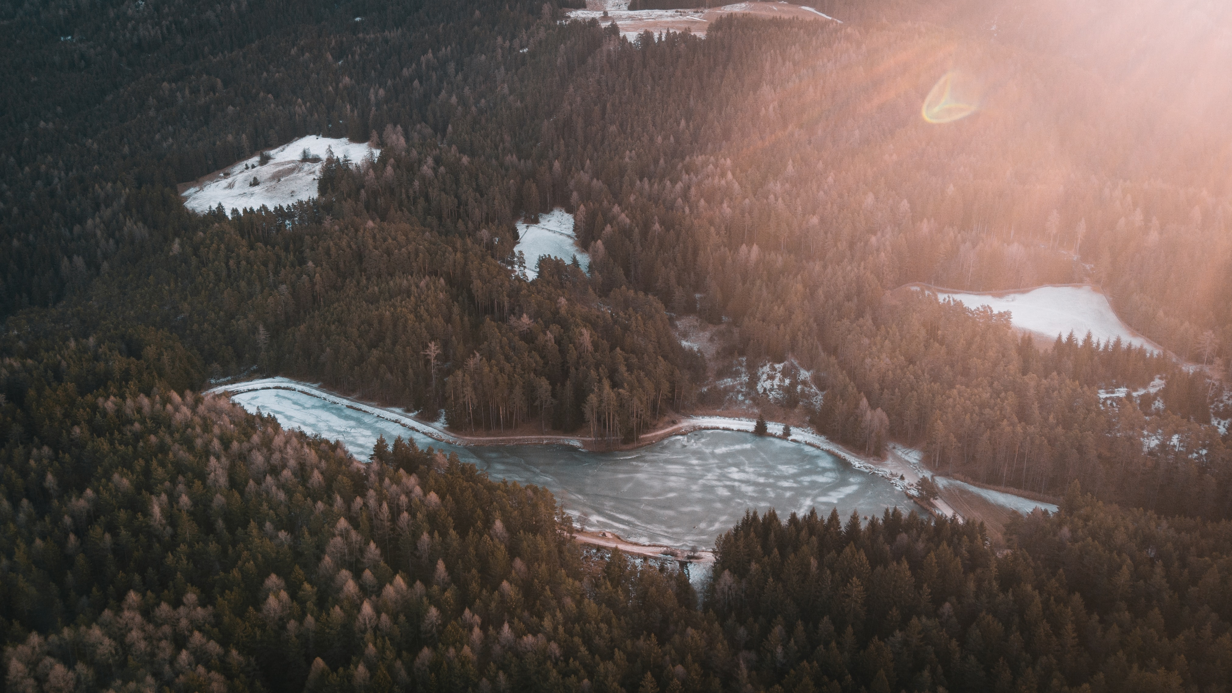 birds eye photography of body of water near forest