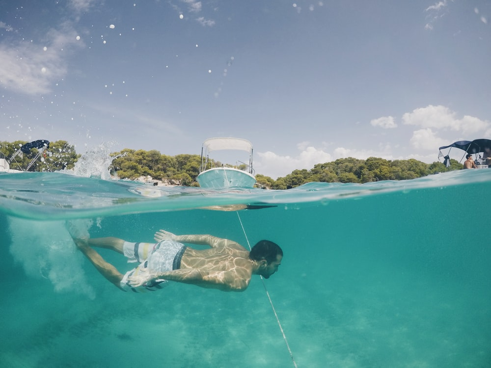 man diving in pool