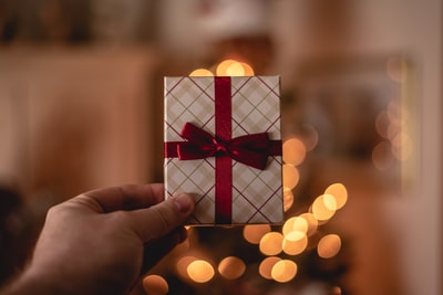 person holding white gift card present teams background