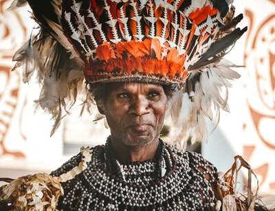 man wearing head dress guinea-bissau zoom background