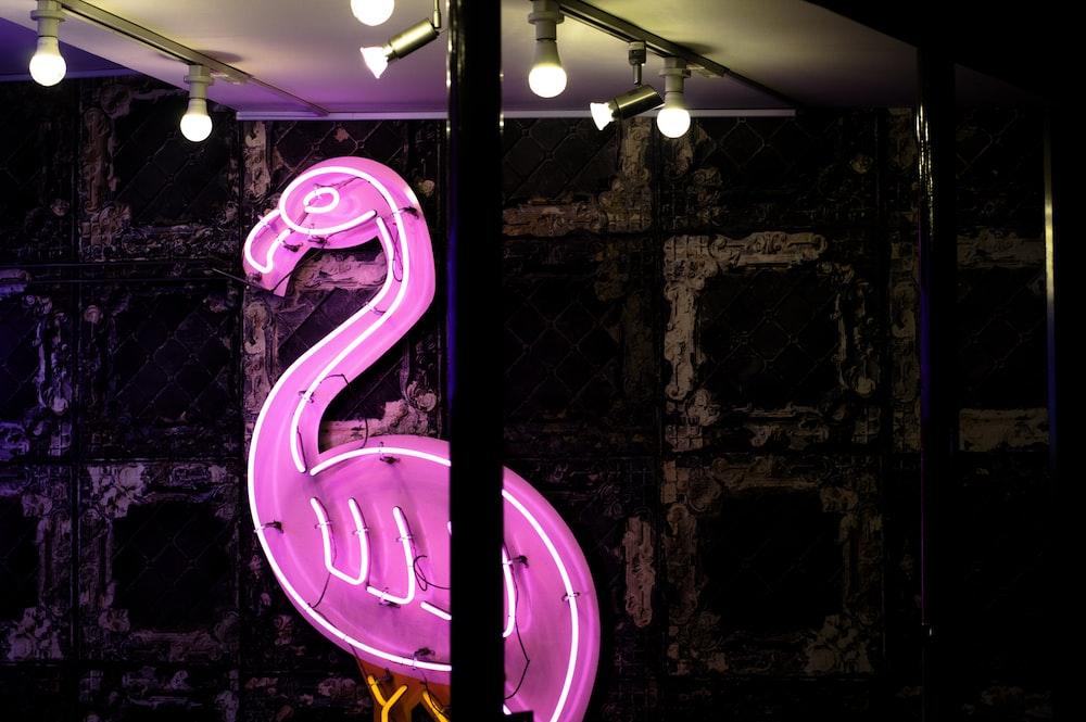 purple and white flamingo LED signage
