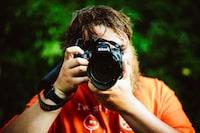 black Nikon DSLR camera with bag