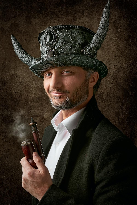 man holding smoking pipe