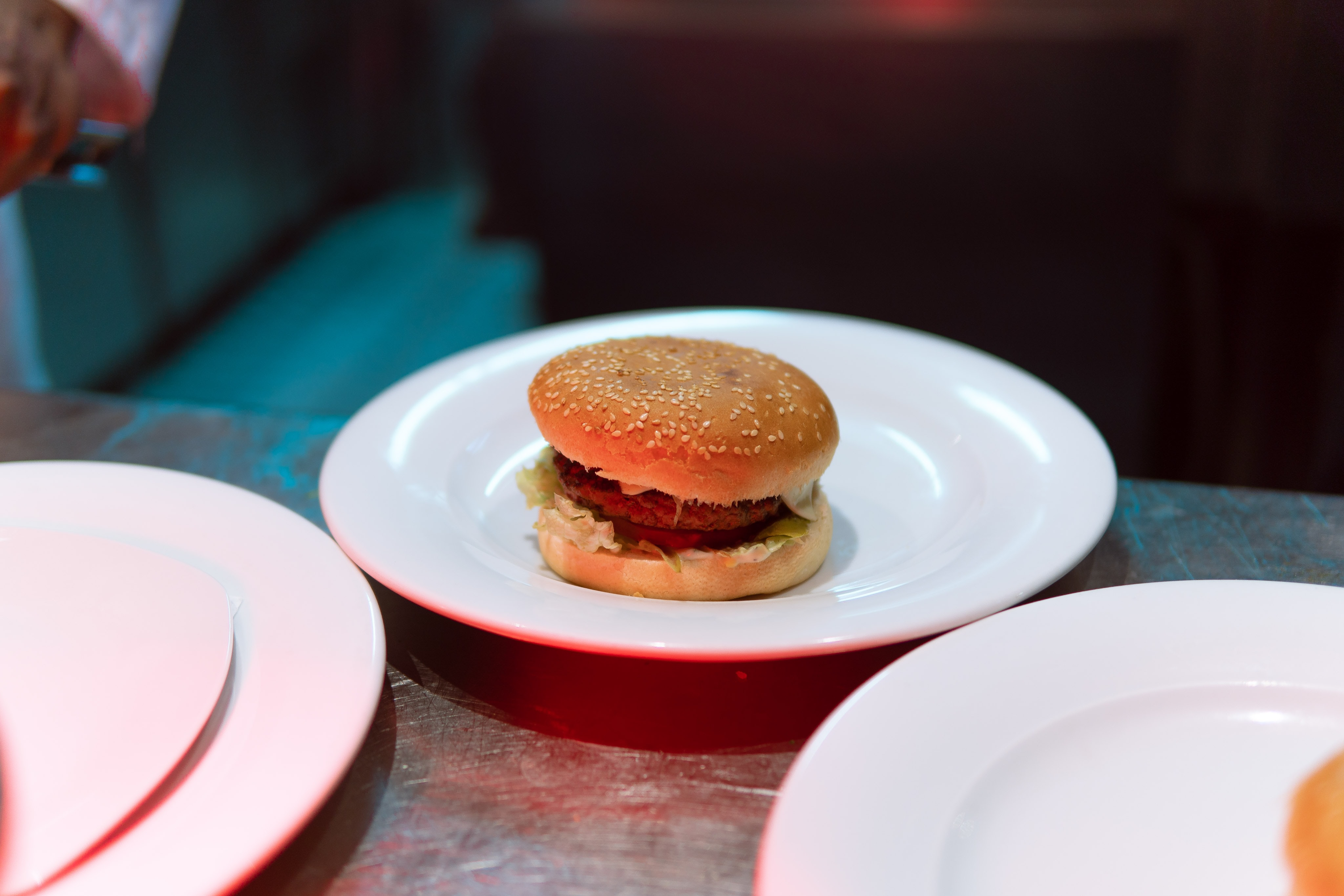 patty with bun on white plate