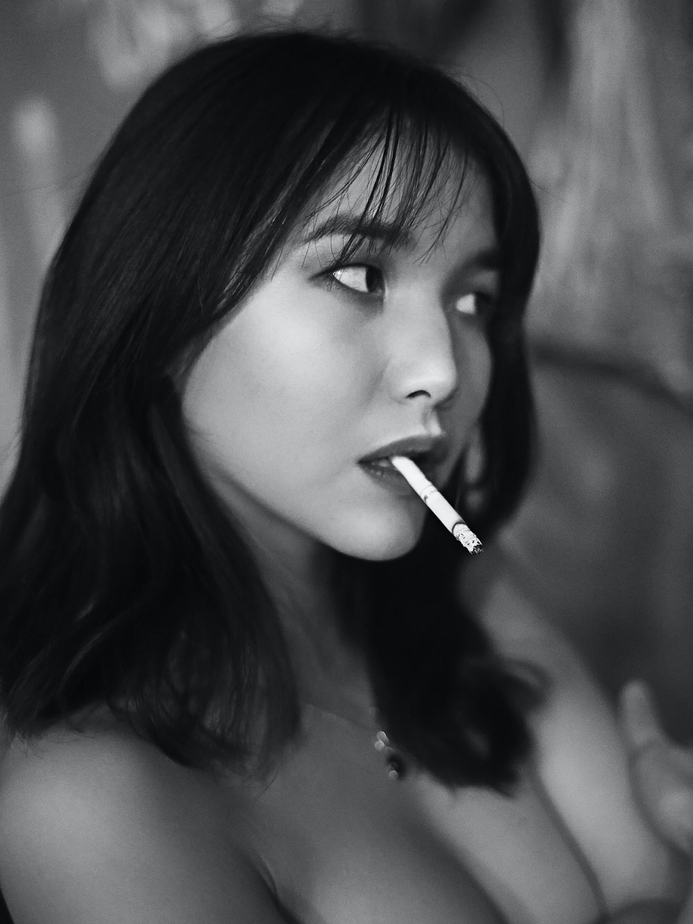 woman with cigarette on mouth