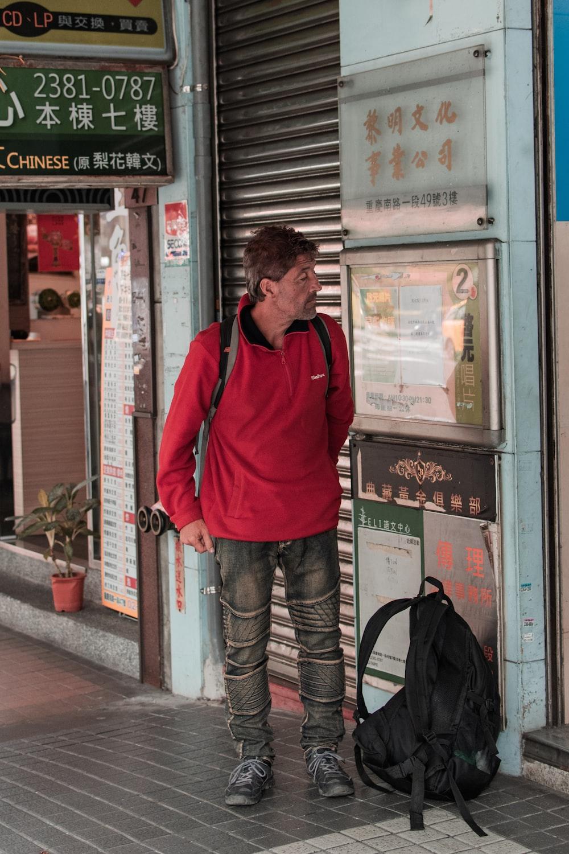 man standing near closed roller shutter