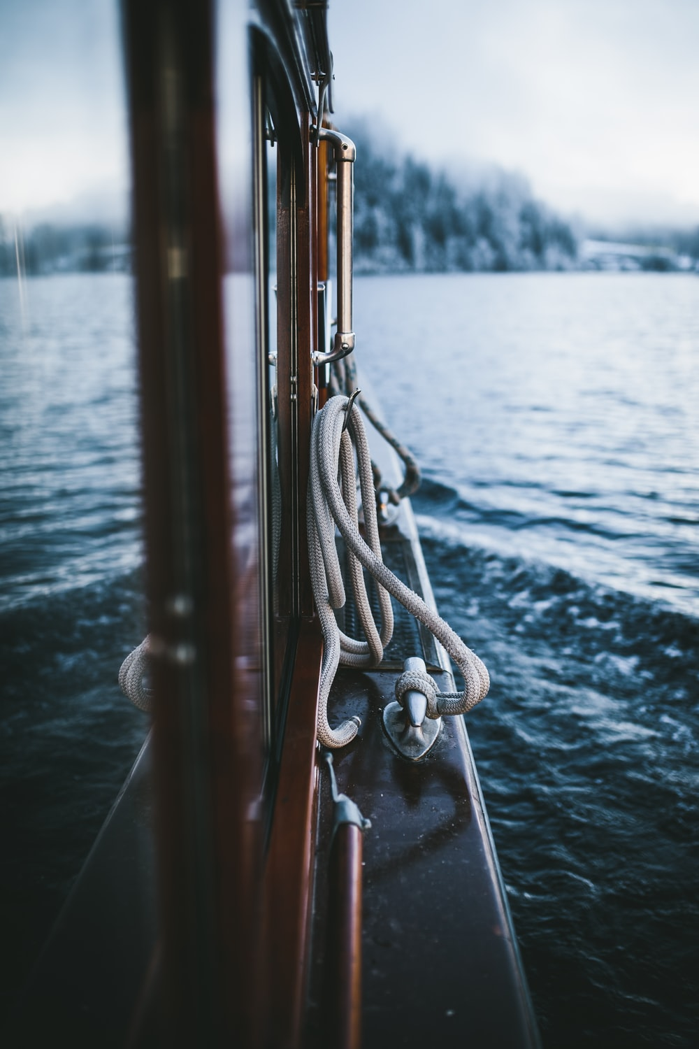 selective-focus photograph of rope beside body of water