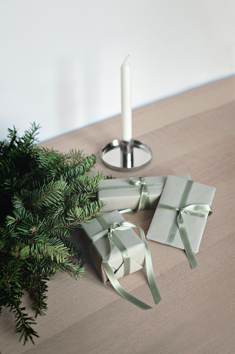 three gift boxes with ribbons on table