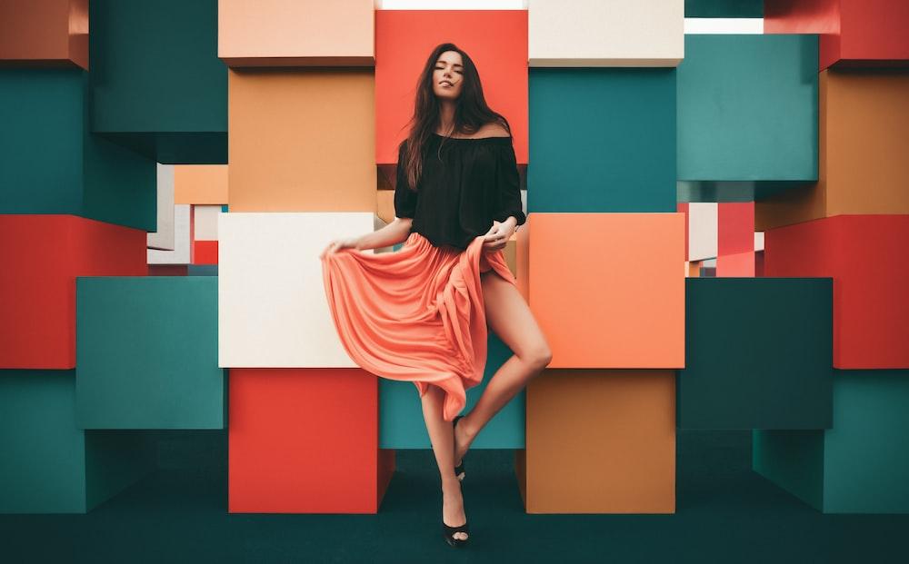 woman holding orange skirt