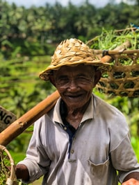 man in grey polo shirt carrying baskets